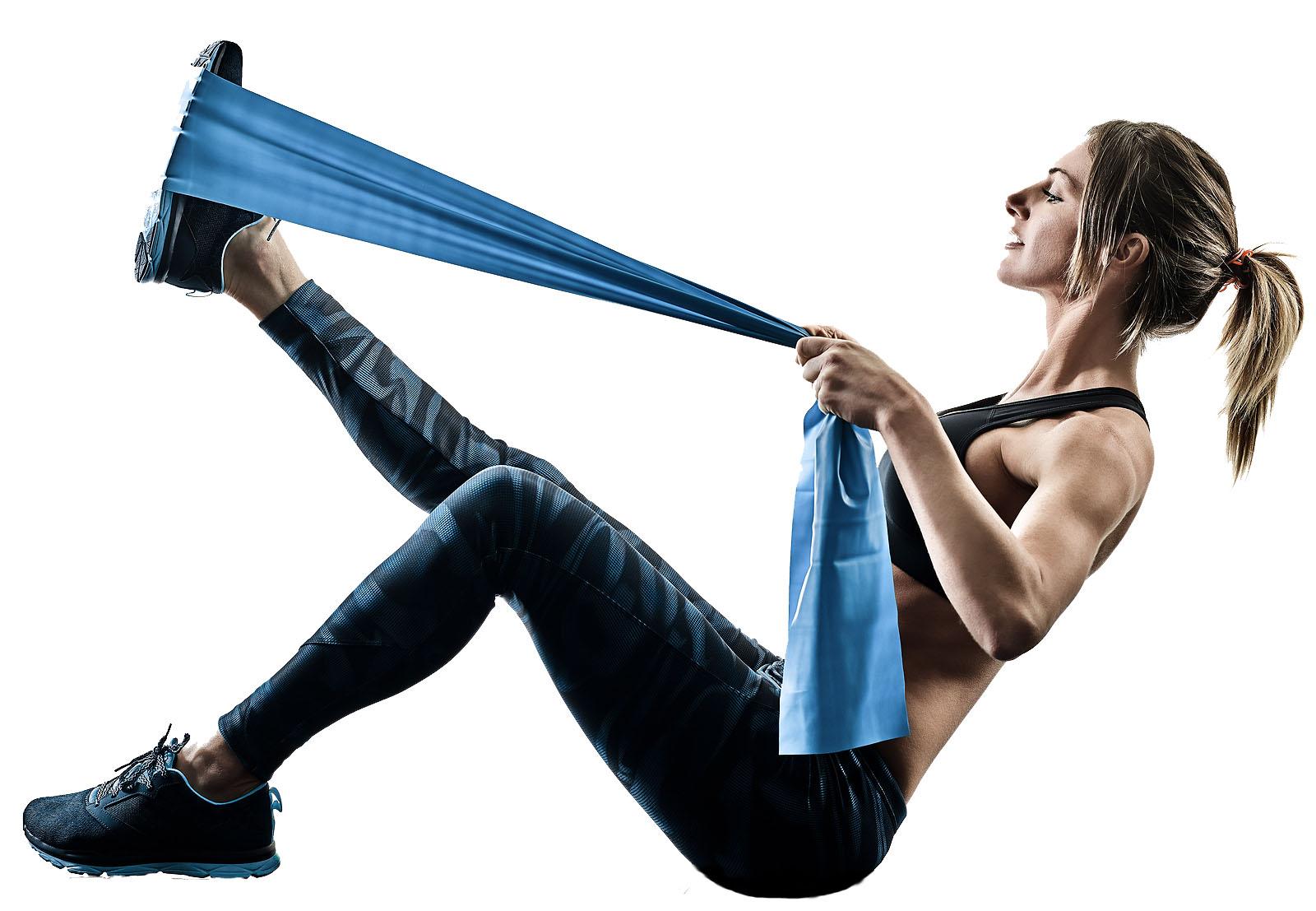 one caucasian woman exercising pilates fitness elastic resistant
