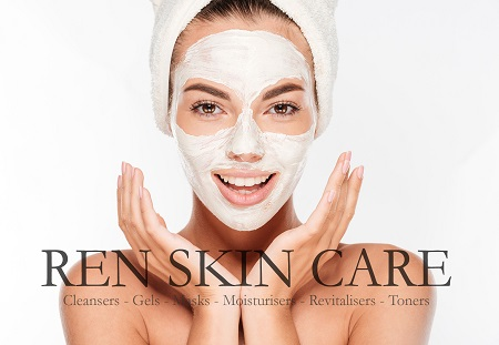 Beautiful smiling woman with white clay facial mask on face isol