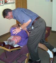 Arcadia Chiropractor Dr. Paul van Berkel giving an adjustment