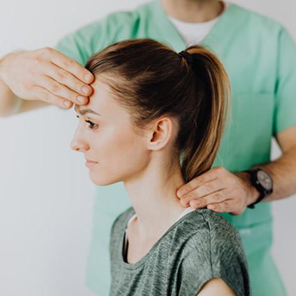 woman receiving neck adjustment