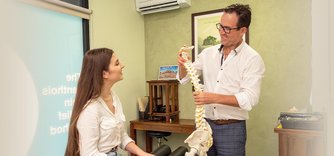 Chiropractor Dr Paul Lanthois holding spine model