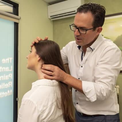 Dr. Paul doing neck adjustment