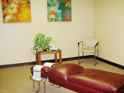 Oversized chiropractic room, utilized for lectures and small groups, such as Tai Chi and yoga.