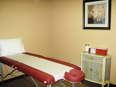 Private acupuncture rooms designed with recessed lighting for a maximized experience.