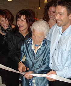 Owners, Dr. Nancy & Mark join Mississauga Mayor Hazel McCallion as she cuts the ribbon at the official Grand Opening celebration of Kore~Energy Chiropractic.