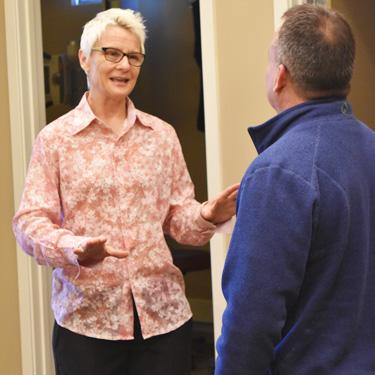 Dr. Bevis talking to patient