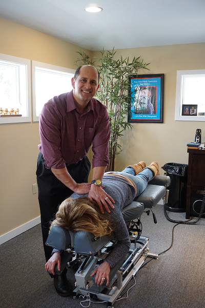 Dr. Sheaffer adjusts a patient