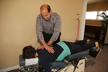 Dr. Sheaffer adjusts a pregnant patient