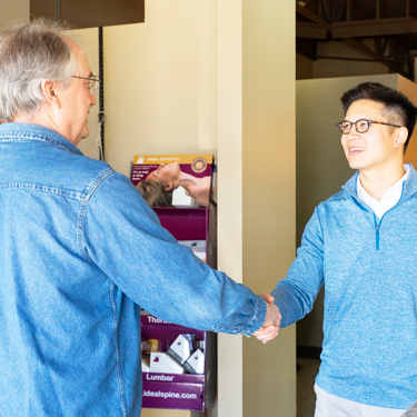Dr. Tran shaking patients hand