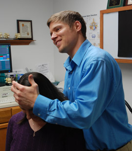 Dr. Lippert at Wealth Of Wellness Chiropractic adjusting a chiropractic patient.