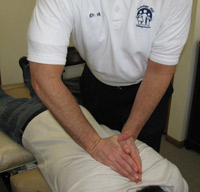 Dr. Ancone using the diversified technique on his patient.