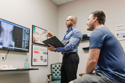Dr Shippy explaining xrays to patient