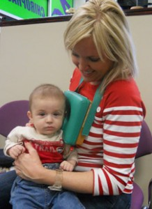 Montgomery Chiropractor, Dr. Yolonda Zink works with a young patient.
