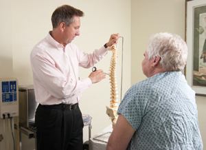 Dr. Major, Temple Terrace Chiropractor, explaining a condition to the patient