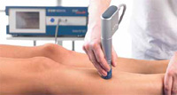 shockwave-therapy being used on a leg