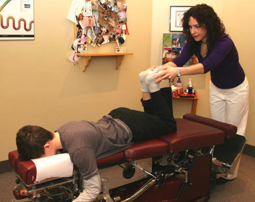 adjusting a patient at Meadowvale Chiropractic &  Massage in {PJ}