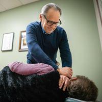 Dr. Miller adjusting a patient