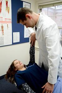 Doctor adjusting a patient