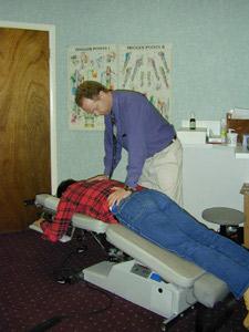 Patient receiving a low back adjustment