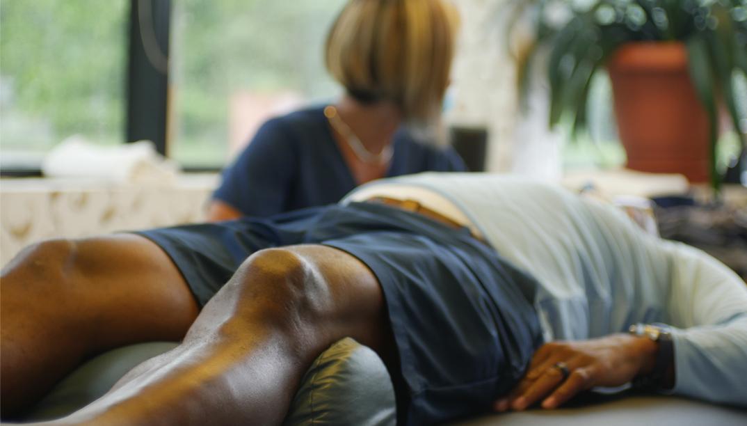 man lying on adjusting table