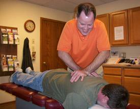 Fort Wayne Chiropractor, Dr. Ruckel adjusting a clients upper back.