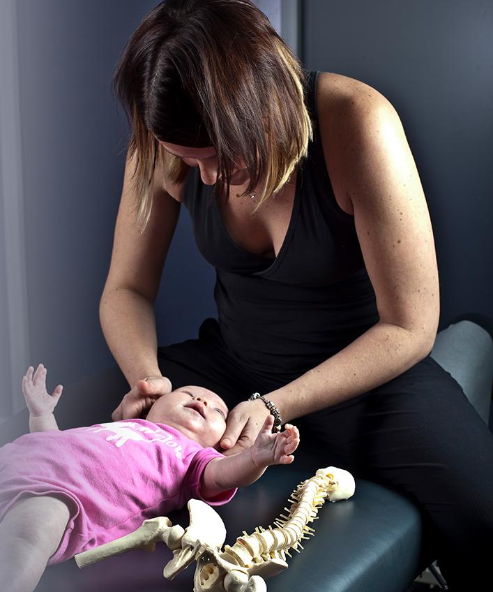 Dr. Lindsey adjusting infant
