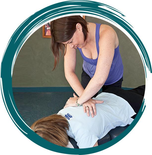 Dr. Lindsey adjusting womans back