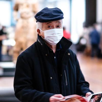 elder man wears mask