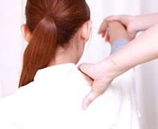 Woman getting shoulder adjusted