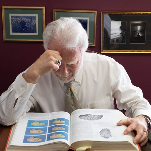 Dr. Harte looking at book