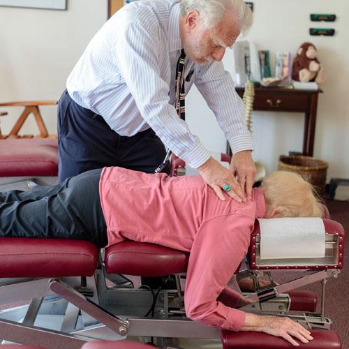 Dr Harte adjusting senior patient