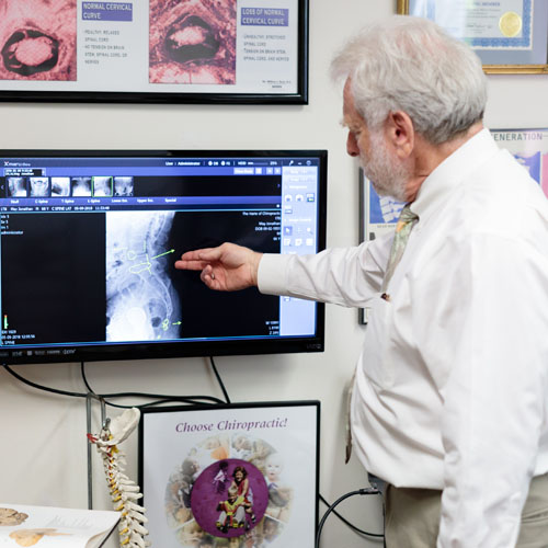 Dr. Harte pointing to computer screen