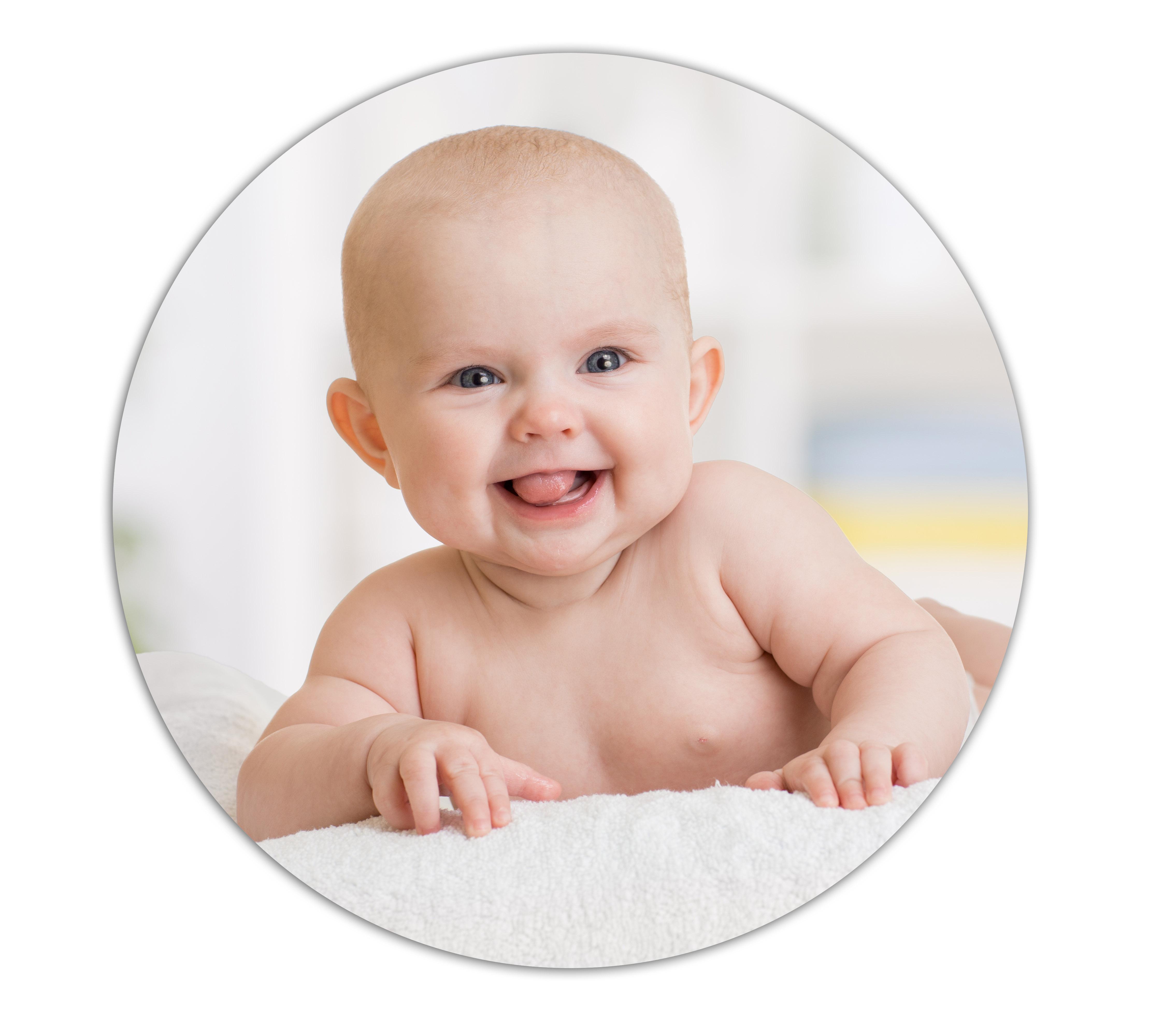 smiling baby girl lying on towel