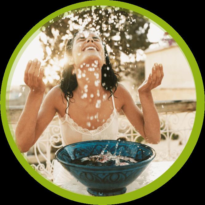 Woman splashing water on her face