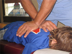 Dr. Mastellone adjusting a young patient.