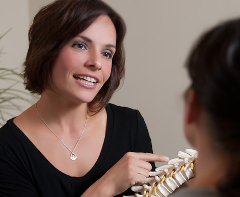 South Portland Chiropractor speaking with patient
