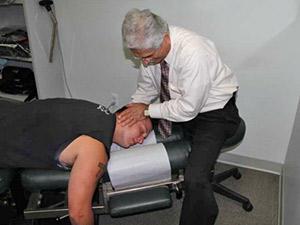 Dr. Auerbach adjusting a patient during a regular visit.