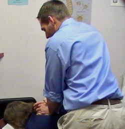 Dr. O'Keefe adjusting a patient