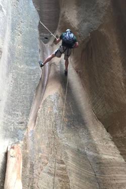 Dr. Luper rock climbing