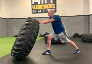 Man flipping very large tire