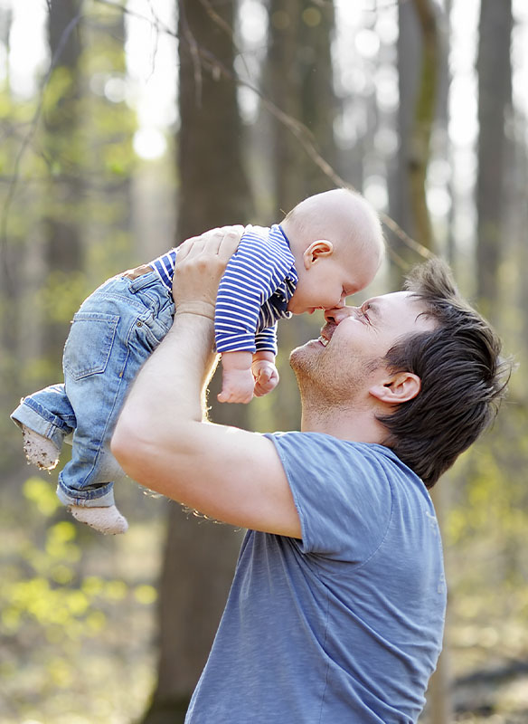 Father holding up child