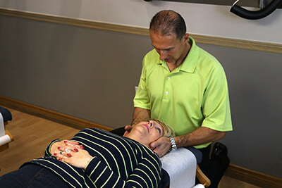Dr. Weyrauch giving chiropractic adjustment
