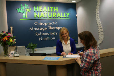 Staff checking in patient at front desk