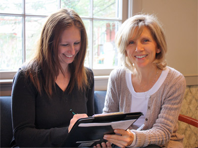 Photo of staff member and patient filling out paperwork together