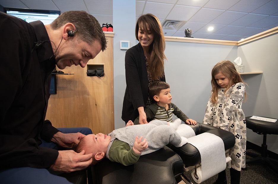 Dr. Mark adjusting baby on table