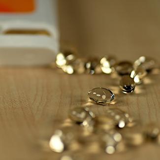 liquid vitamin capsules on a tabletop
