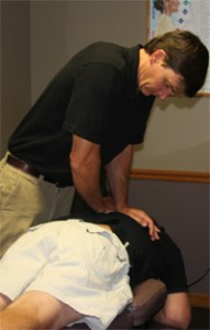 Dr. Kinnard adjustmenting a patient