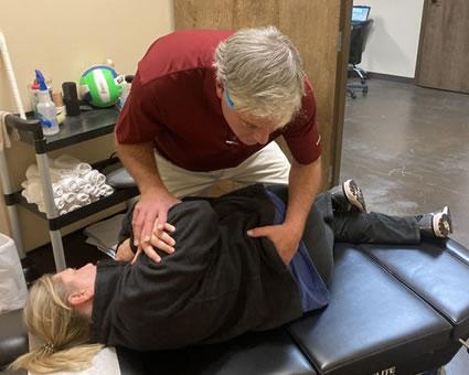 Doctor doing side adjustment