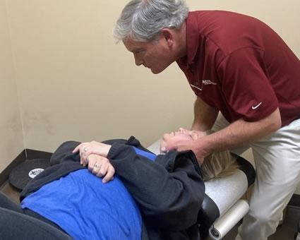 Dr. Ben adjusting womans neck