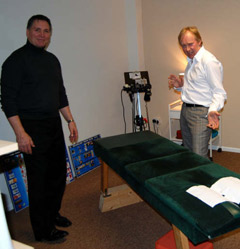 Dr. White (D.C.) at the adjusting table with a real character